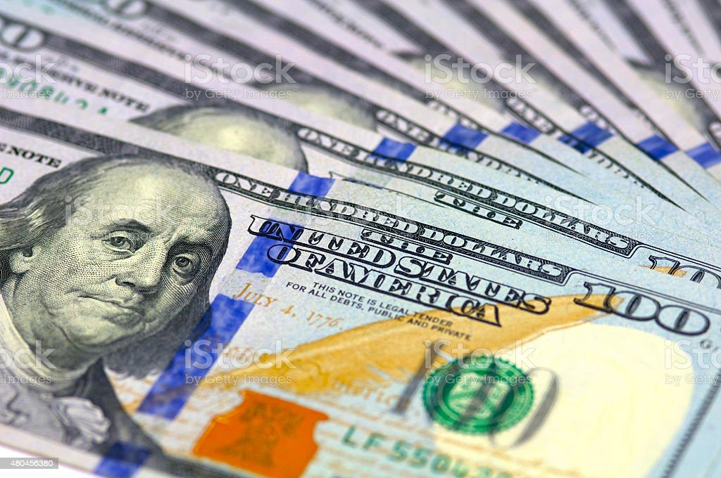 $100 bills background closeup stock photo