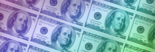 $100 bills background (with color gradient) stock photo