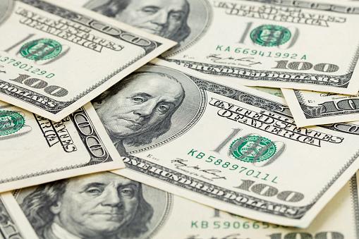 693363558 istock photo $100 bills background 1199967963