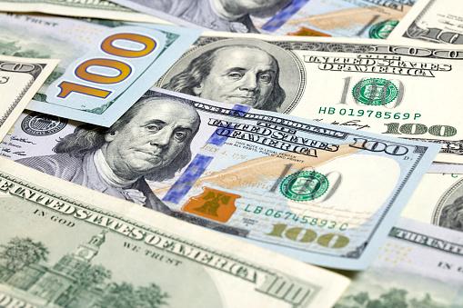 693363558 istock photo $100 bills background 1201917488
