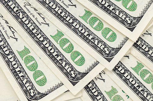 693363558 istock photo $100 bills background 1201917753