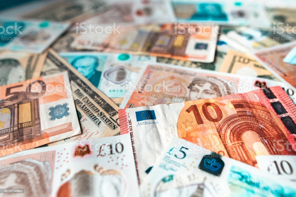 Bills of different currencies stock photo