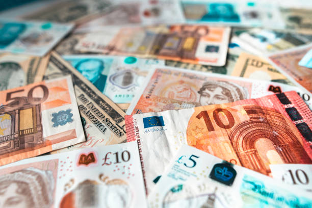 Bills of different currencies stock photo