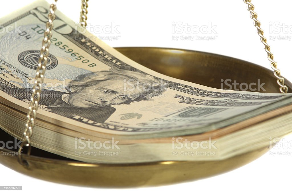 Bills on a scale royalty-free stock photo