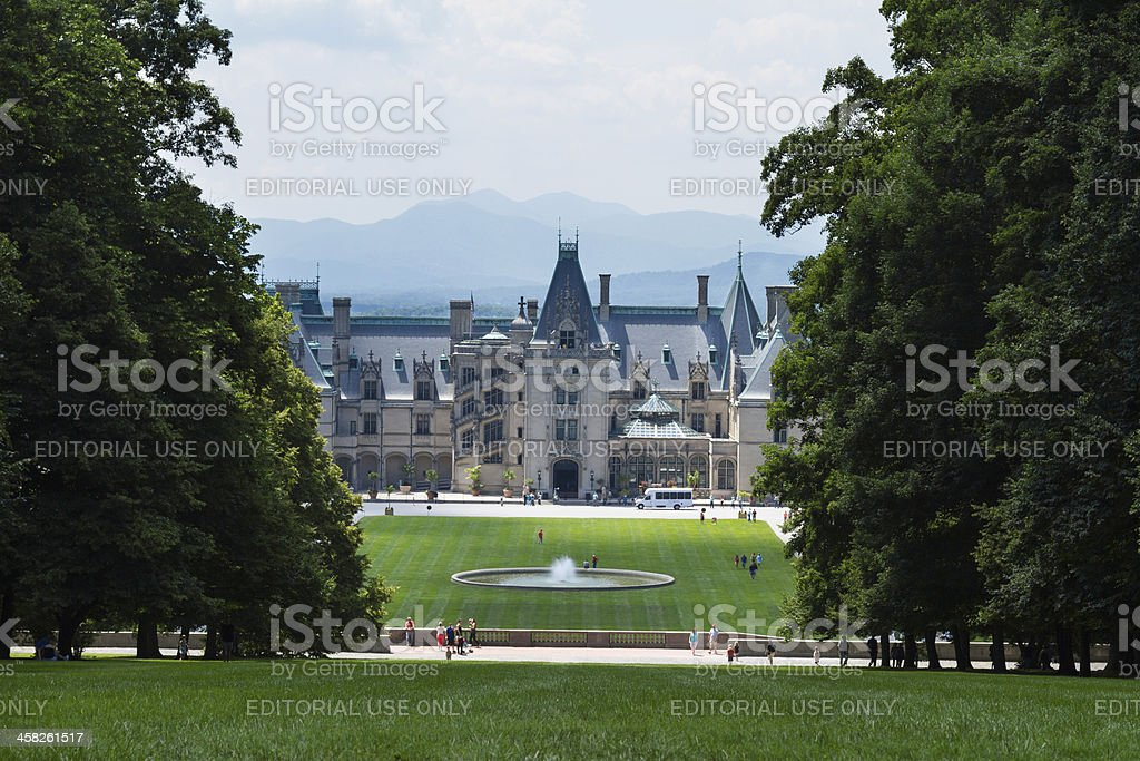 Biltmore House shines through the trees. stock photo
