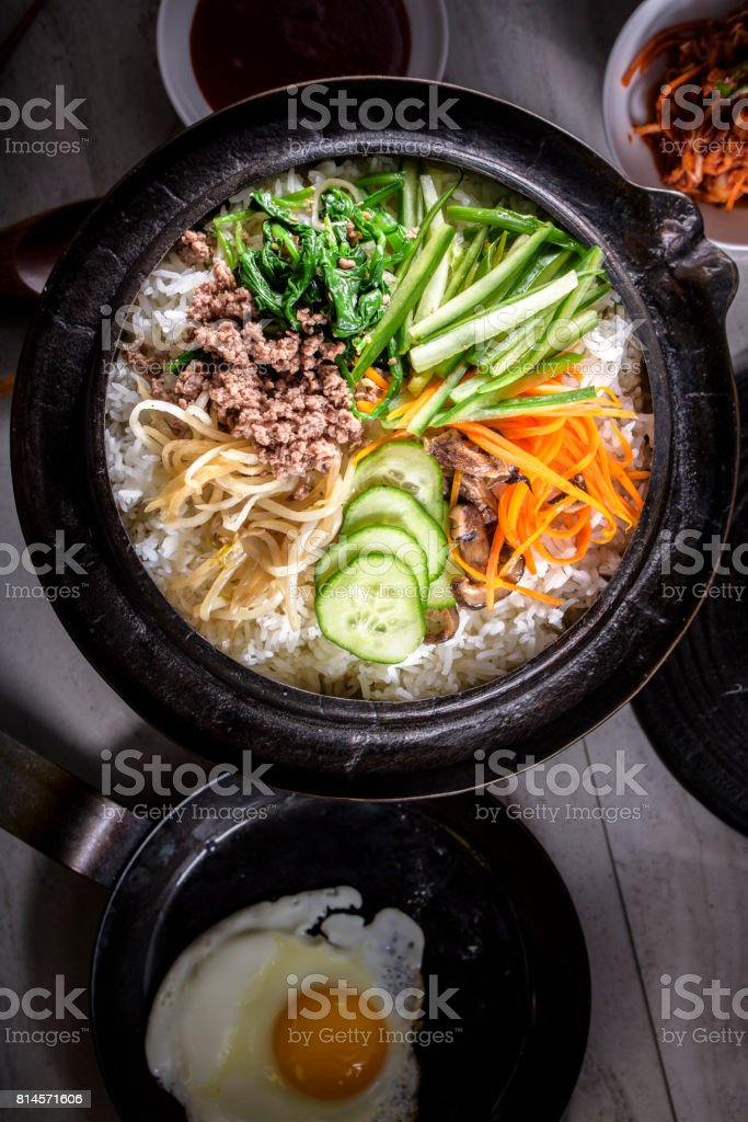 BI Bim Bap, Rice with Mixed Vegetables, top view with Hot Sauce in Cast Iron Pot stock photo