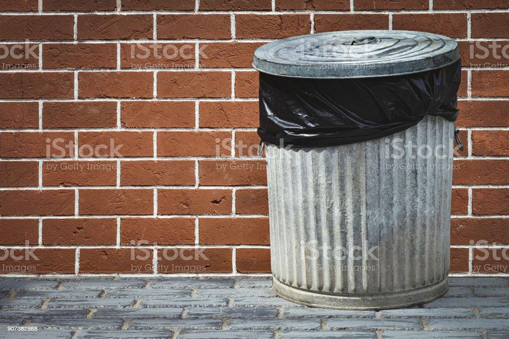 bin and brick wall royalty-free stock photo