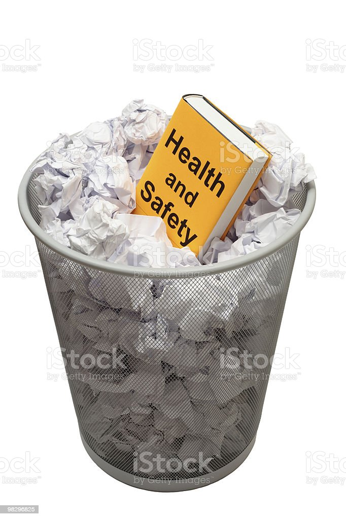 Bin containing book with Health And Safety on the cover royalty-free stock photo