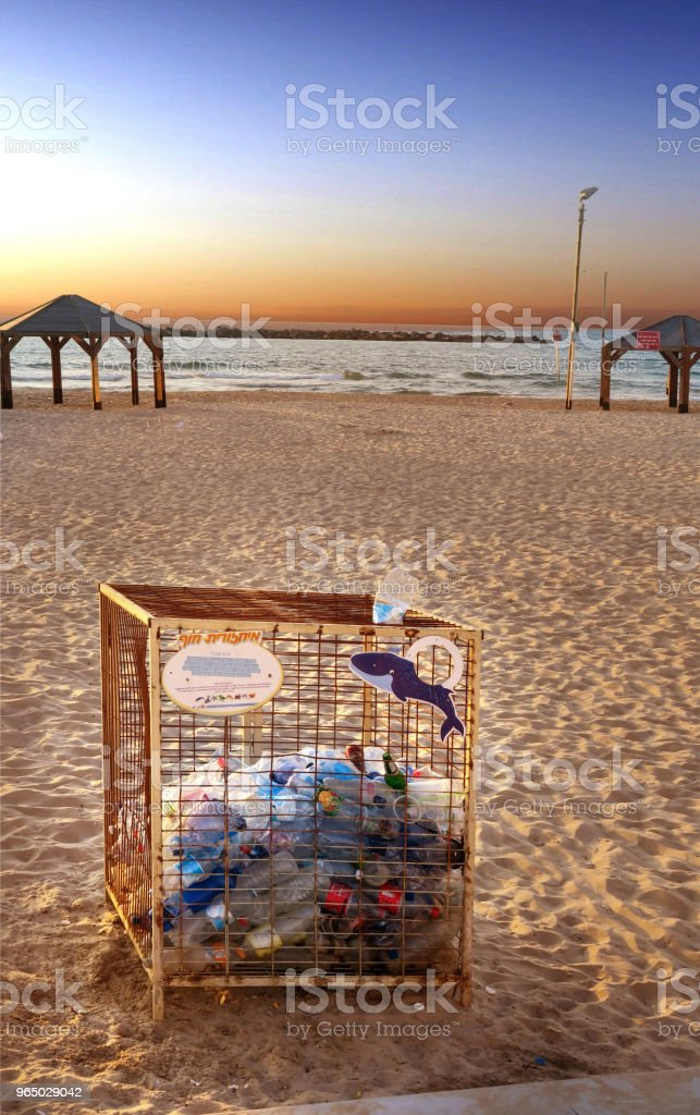 bin for plastic container recycling on the beach in downtown tel aviv, israel royalty-free stock photo