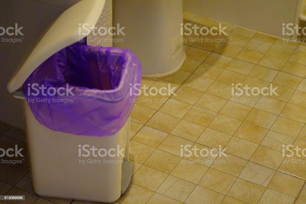 bin in toilet stock photo