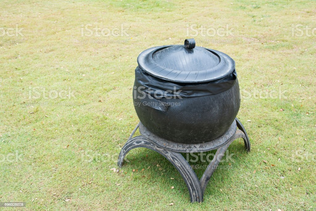 Bin made from old tires in the park.Garbage bin made from old tires stock photo