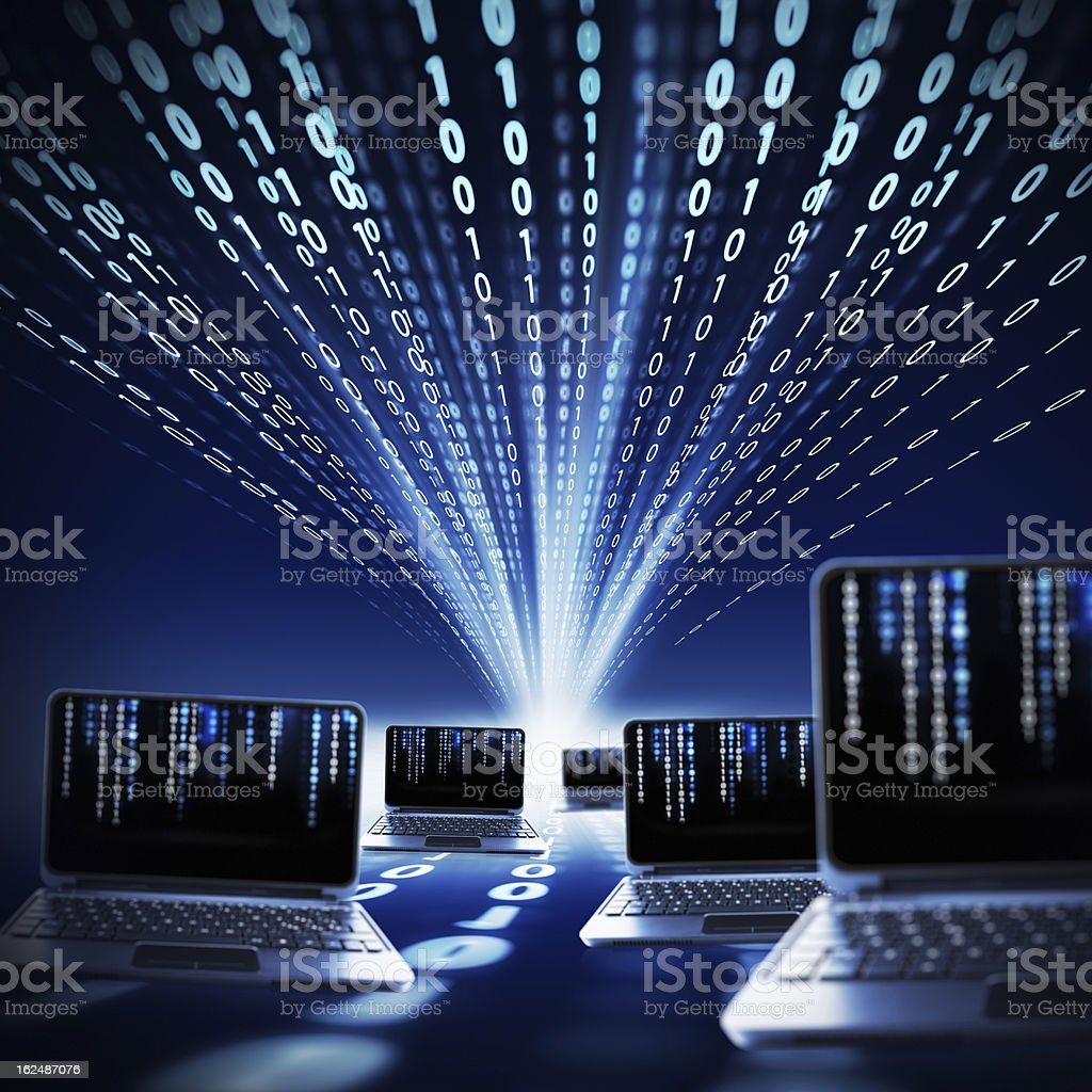 binary code and laptops stock photo