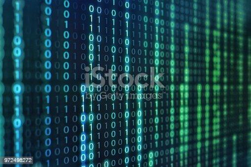 1150846798istockphoto binary code data bit screen display on laptop computer screen. matrix of data flow. Rise of the big data AI age. artificial intelligence data transfer. Digital concept, high tech defocused blue light 972498272
