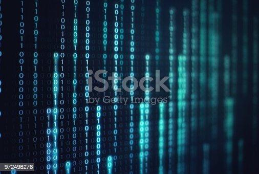 1150846798istockphoto binary code data bit screen display on laptop computer screen. matrix of data flow. Rise of the big data AI age. artificial intelligence data transfer. Digital concept, high tech defocused blue light 972498276