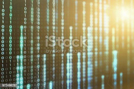 1150846798istockphoto binary code data bit screen display on laptop computer screen. matrix of data flow. Rise of the big data AI age. artificial intelligence data transfer. Digital concept, high tech defocused blue light 972498282