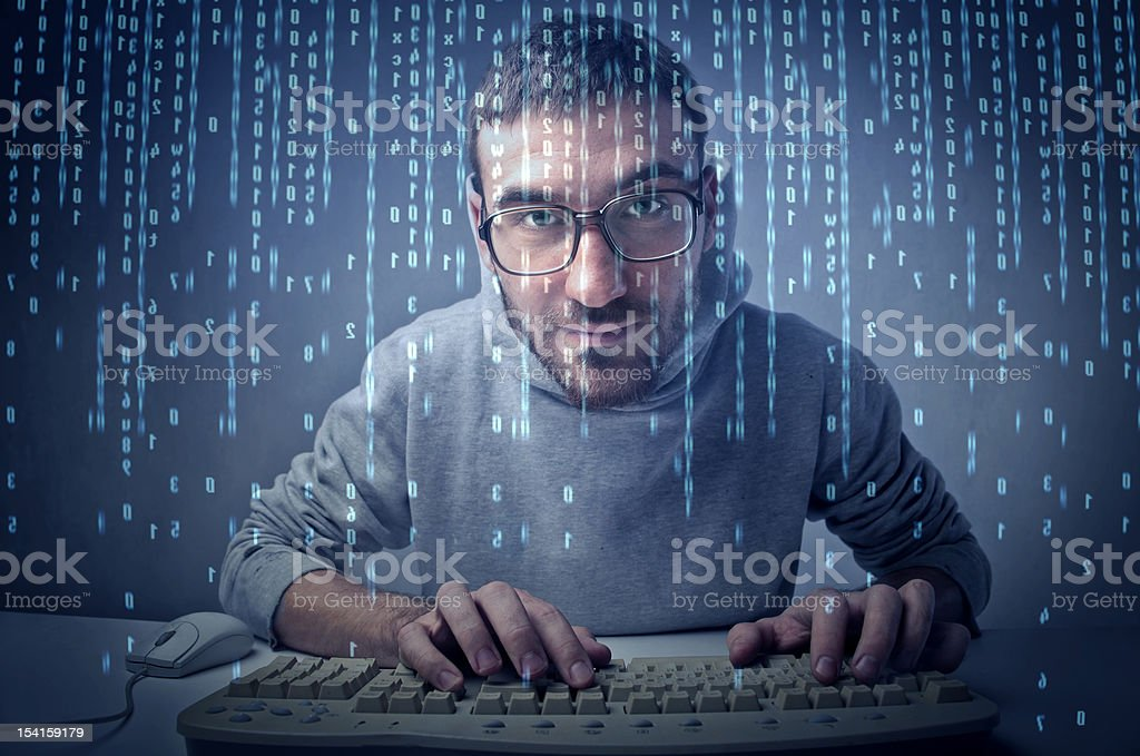 Binary code Young man typing on a computer keyboard with binary code passing on the screen Adult Stock Photo