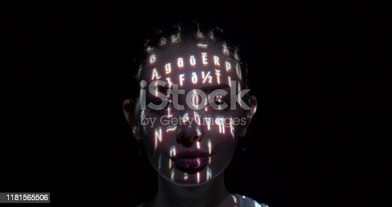 Binary data projected on a woman's face.