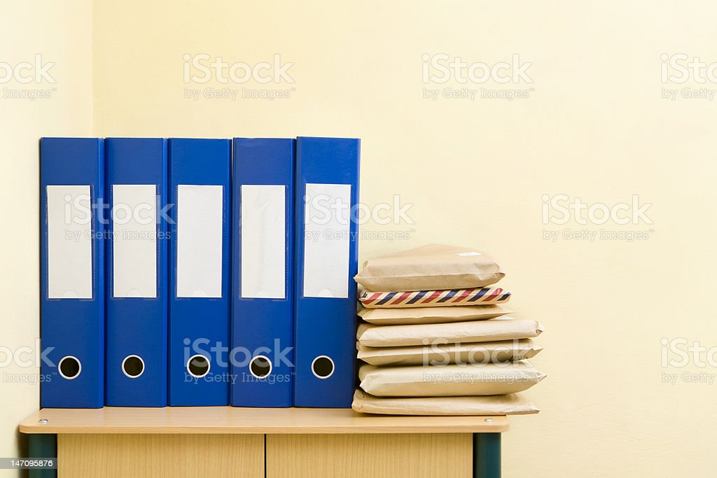 Binder and mail package stock photo