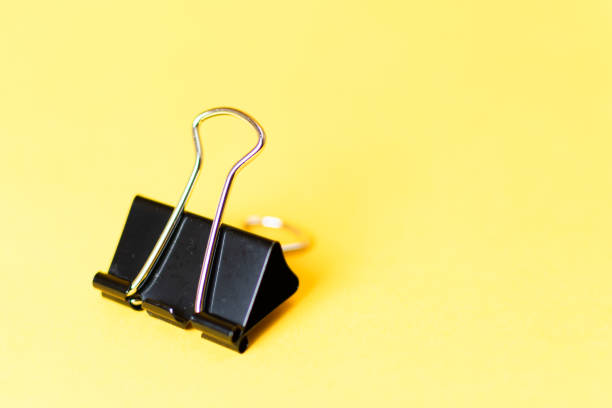 binder clip on colorful background stock photo