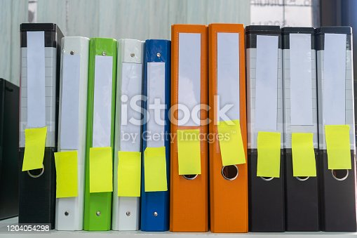 istock Binders file Paperword, Documents with stiky note and blank label on shelf in archive Files folder on shelf in office, Annual Report document for Business papers financial market or research achieves 1204054298