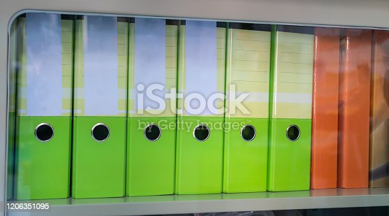 istock Binders file Paperwork, Documents with stiky note and blank label on shelf in archive Files folder on shelf in office, Annual Report document for Business papers financial market or research achieves 1206351095