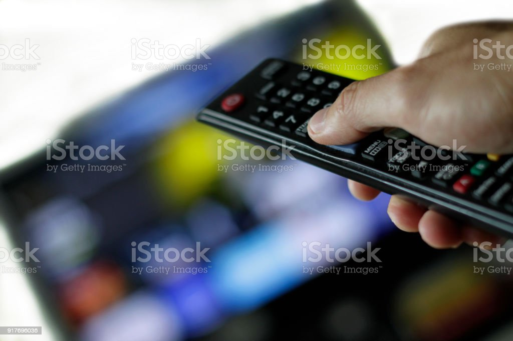 Binge watching and remote control stock photo