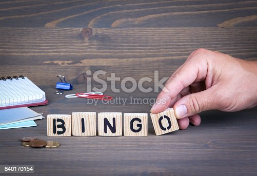 istock Bingo. Wooden letters on dark background 840170154
