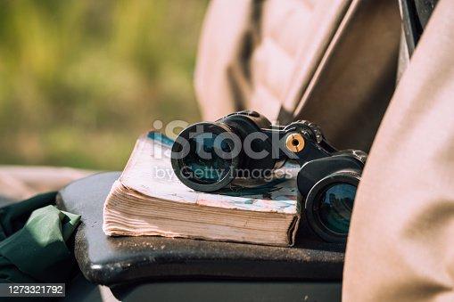 Binocular and book lying in the car