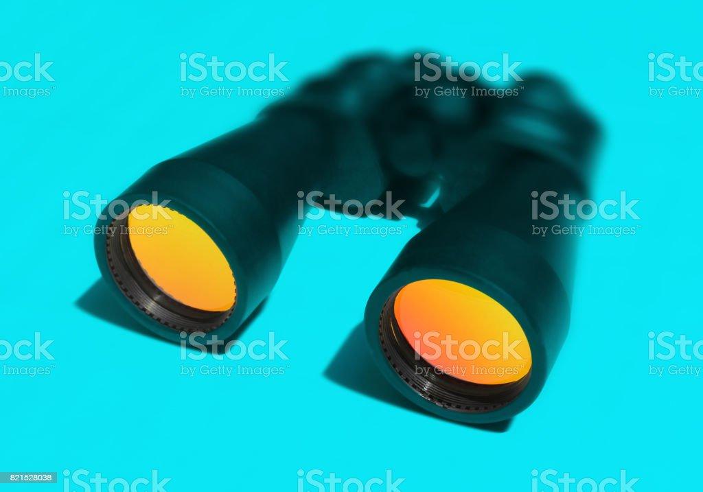 Binocular on Blue Background stock photo