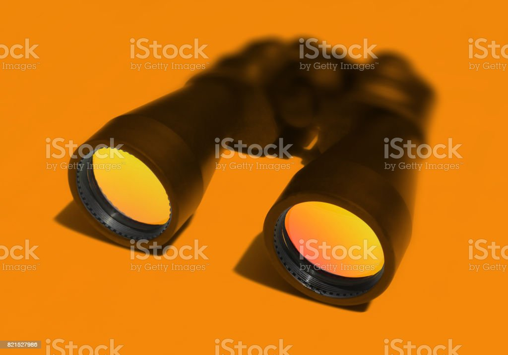 Binocular on Yellow Background stock photo
