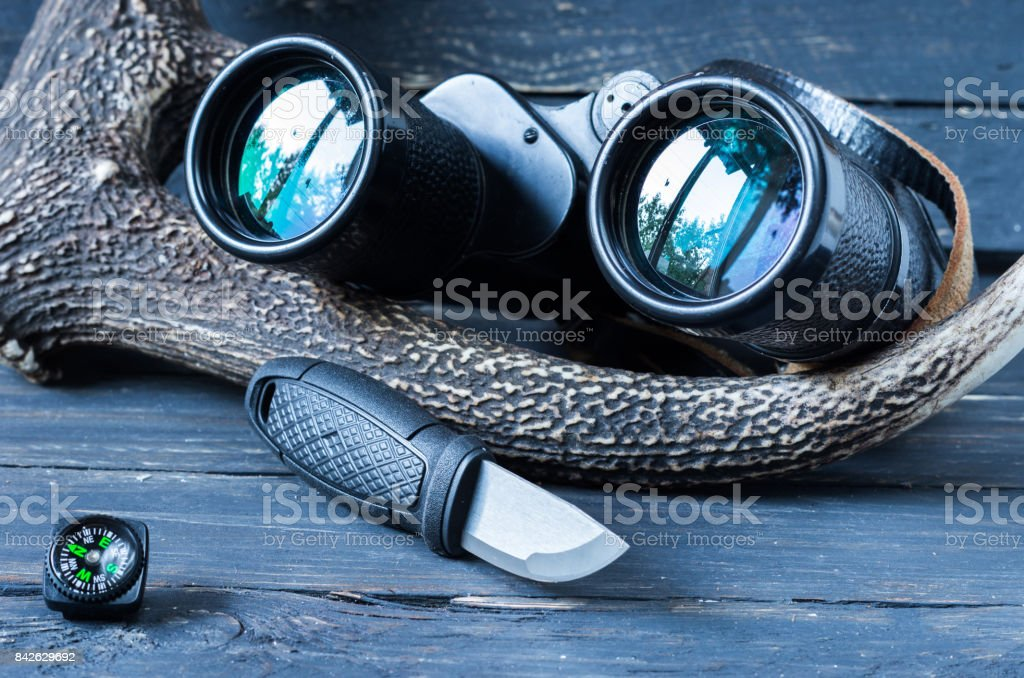 Binoculars and a Swedish knife for hikes. stock photo