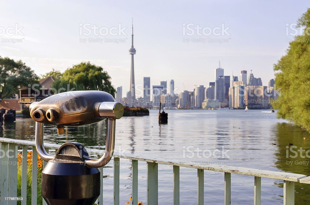 Binoculars and a view of Toronto from island royalty-free stock photo