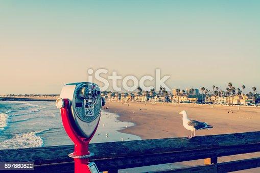 istock Binoculars and seagull in Newport Beach pier 897660822