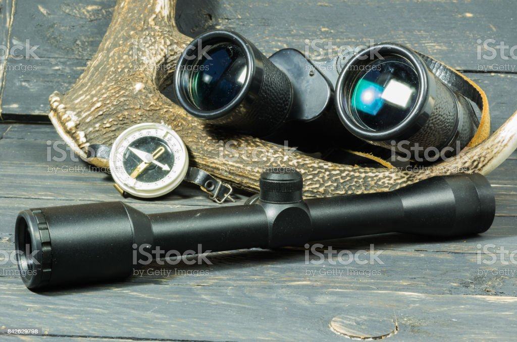 Binoculars and sight for hunting. Hunter compass. stock photo