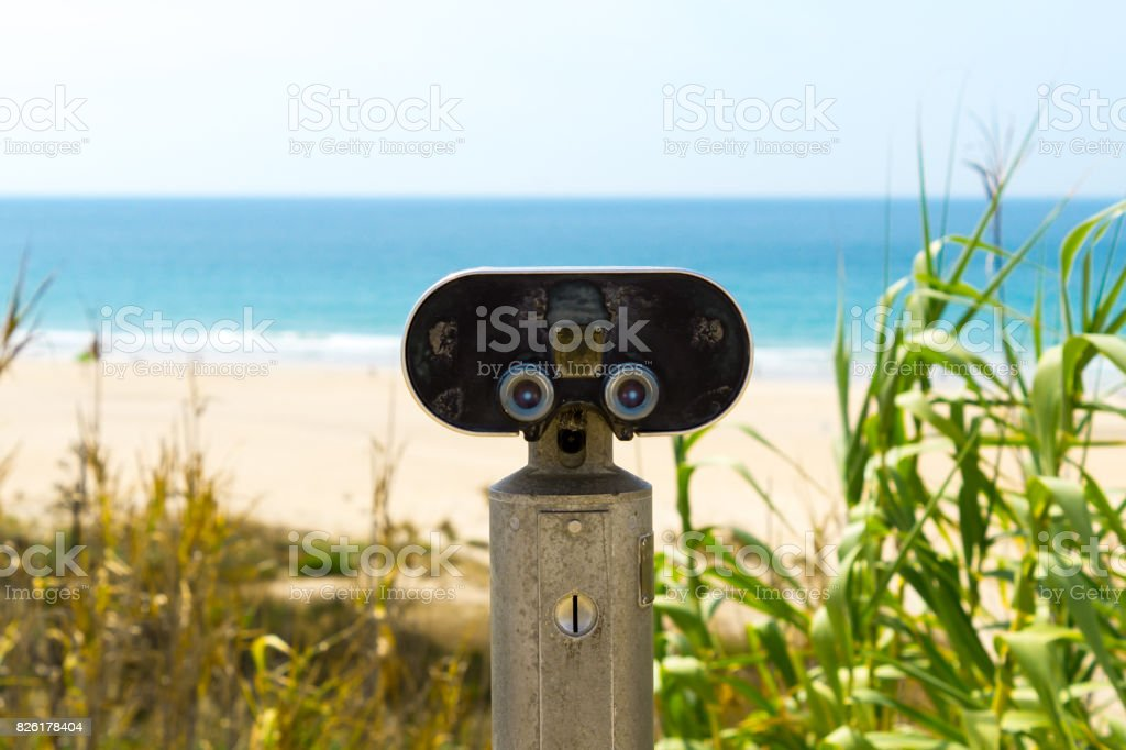 Binoculars pointing out on the sea
