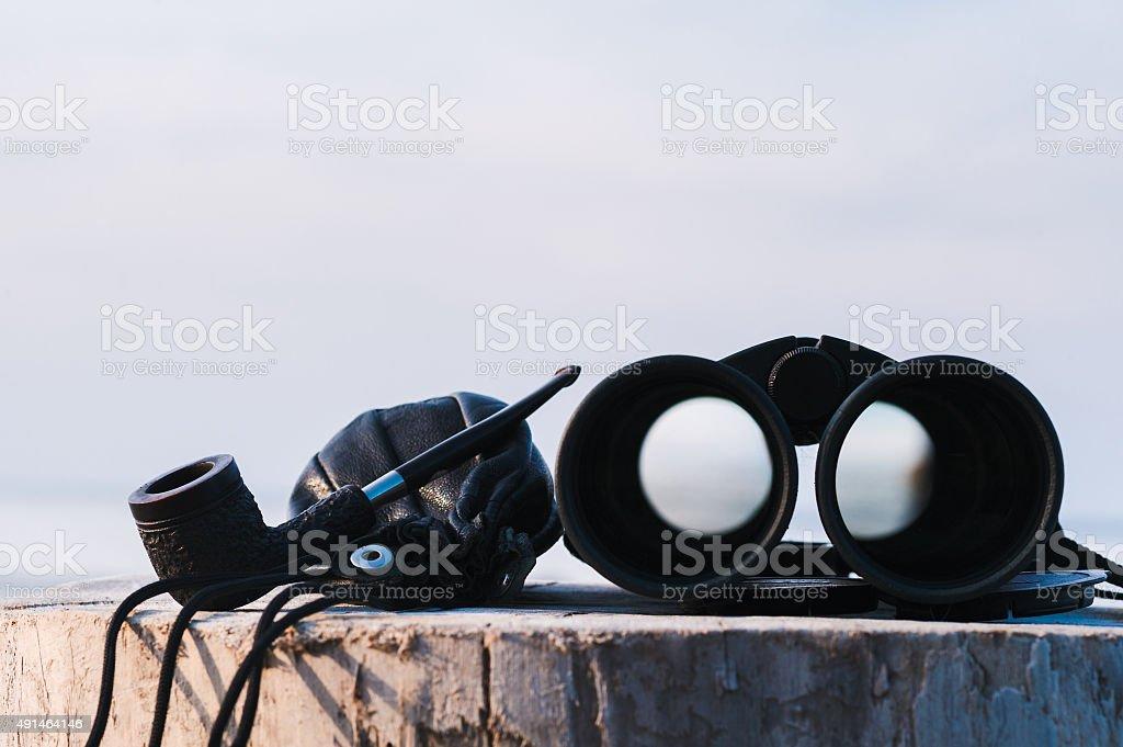 Binoculars on the stump stock photo