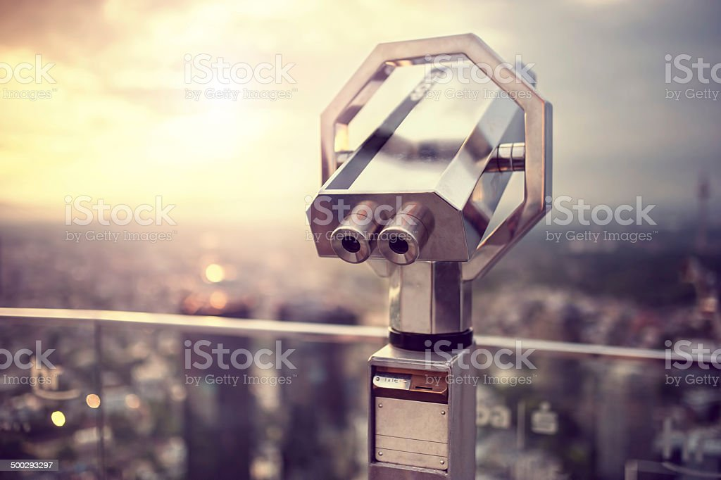 Binoculars or telescope on top of scyscraper at observation deck stock photo