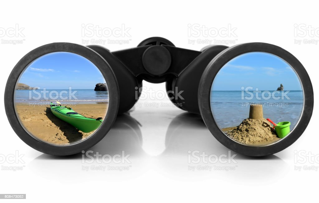 Binoculars Reflecting beach stock photo
