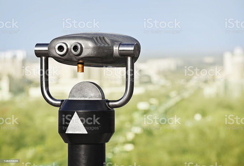 Binoculars to observe green city stock photo