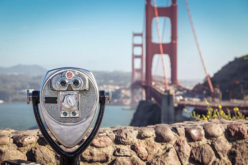 Binoculars with Golden Gate Bridge in the background, San Francisco, California