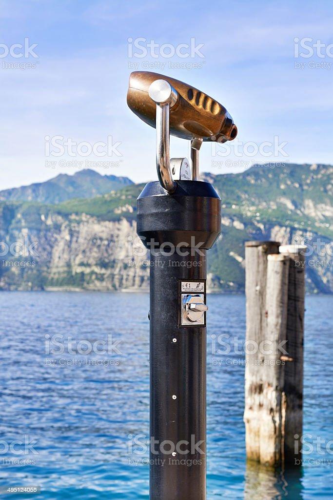Binoculars with view of lake Garda stock photo