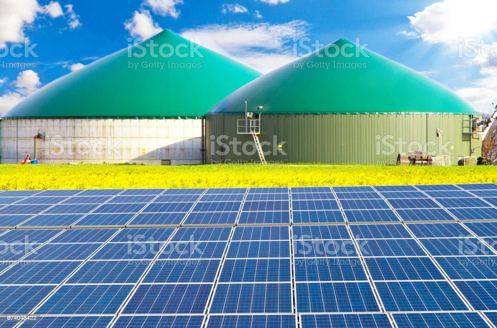 Bio gas plant with sollar cells stock photo