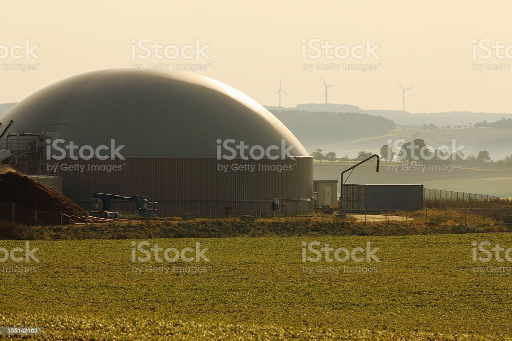bio gas power plant and wind generators for alternative energy stock photo