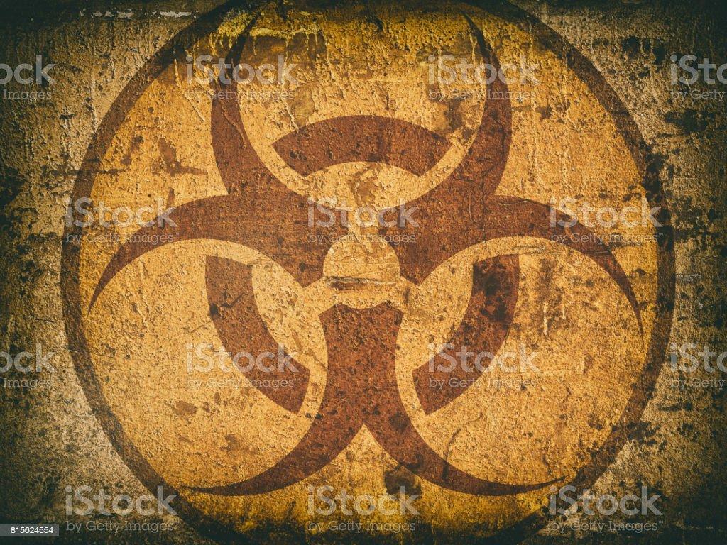 bio hazard symbol on a cracked stone wall stock photo
