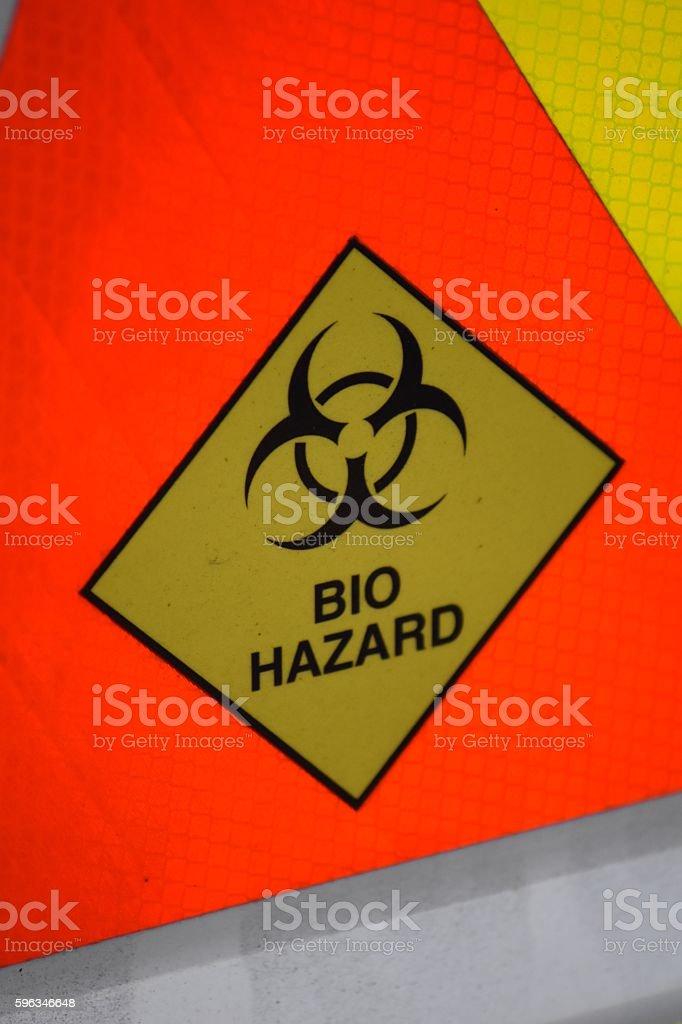 Bio Hazard Warning on reflective orange background royalty-free stock photo