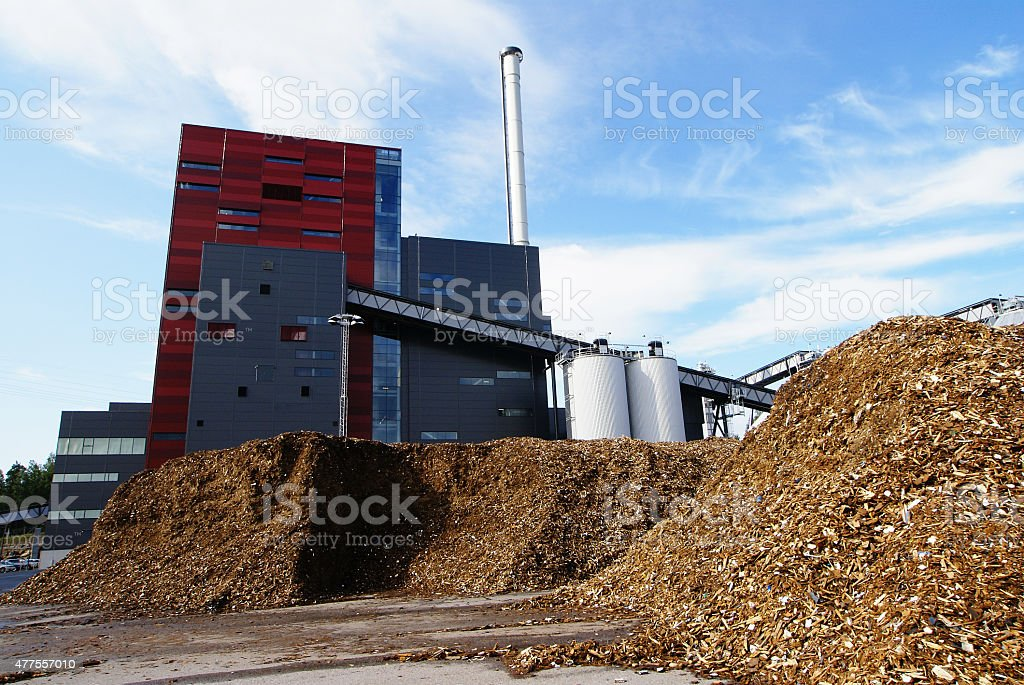 bio power plant against blue sky stock photo
