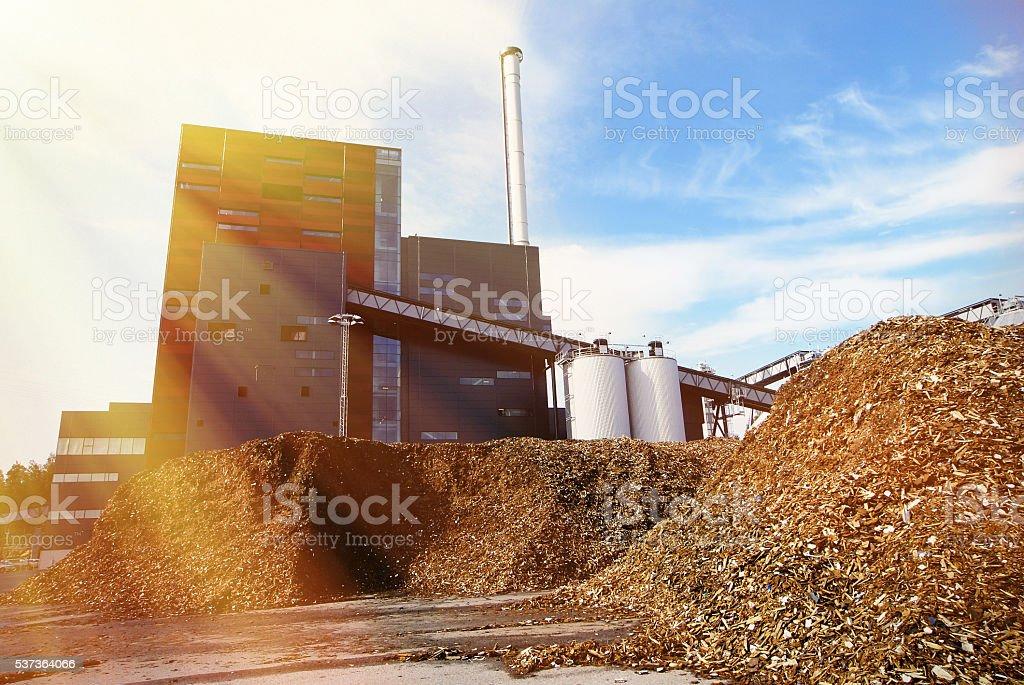 bio power plant against blue sky stock photo