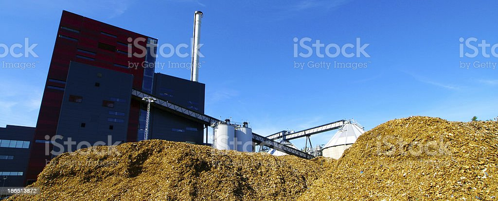 bio power plant with storage of wooden fuel royalty-free stock photo