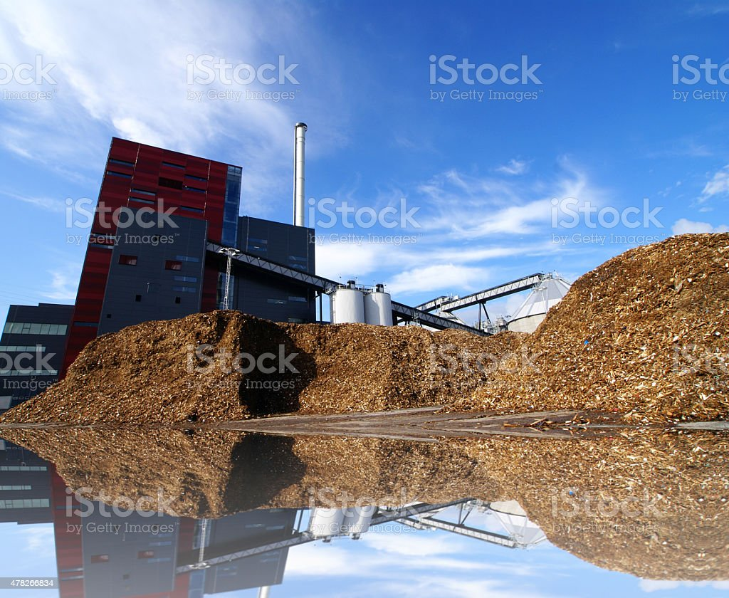 bio power plant with storage of wooden fuel stock photo