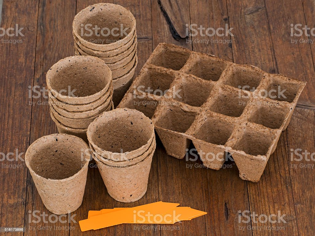 Biodegradable peat pots for sowing seeds stock photo